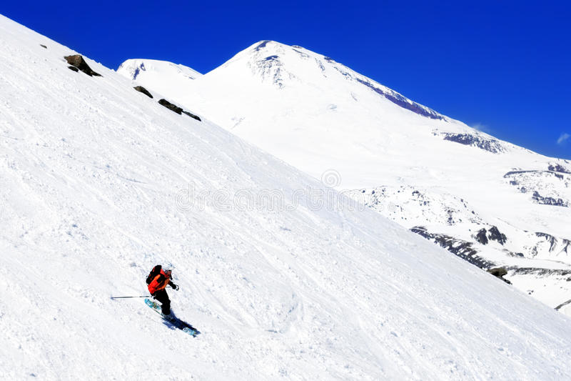 A skier descending Mount Elbrus - the highest peak in Europe. stock photography