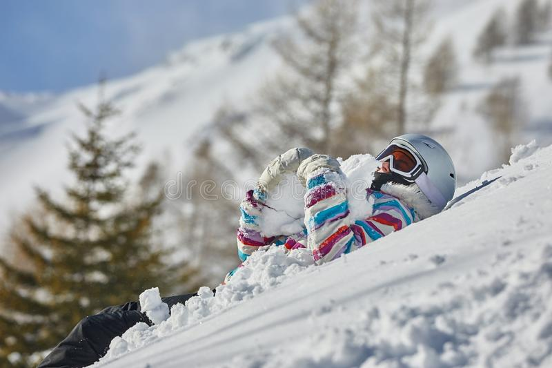 Skier having a rest in the snow stock image