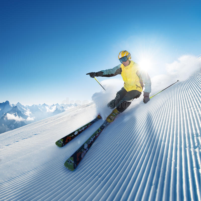 Skier in high mountain. S at sunny day and on prepared and modified piste stock photo