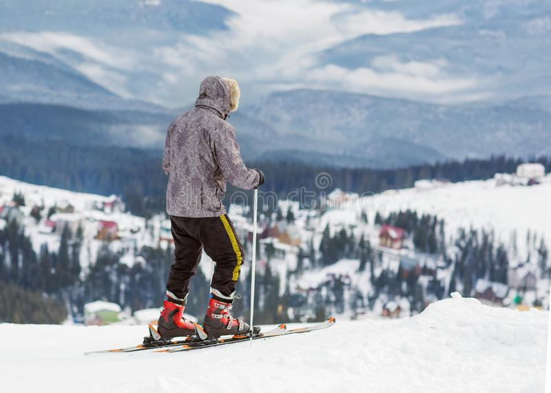 Skier is on a high mountain slope royalty free stock photo