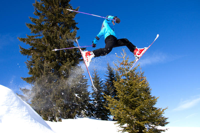 Skier in a jump from a ramp royalty free stock image