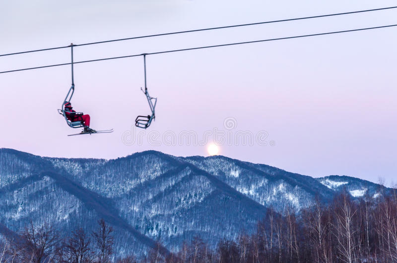Skier on the lift. In the mountain royalty free stock photography