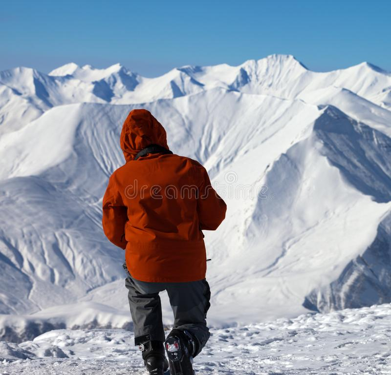 Skier makes photo on top of high snowy mountain stock images