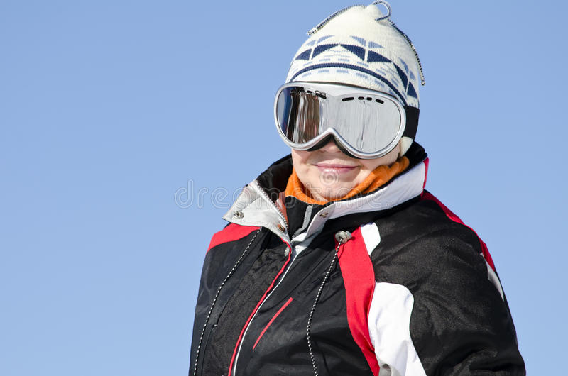 Skier on the mountain top royalty free stock photography