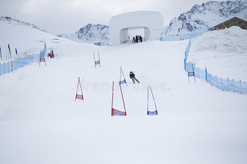 Skier in mountains royalty free stock photography
