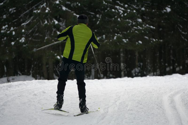 Skier on piste in high mountains . stock photos