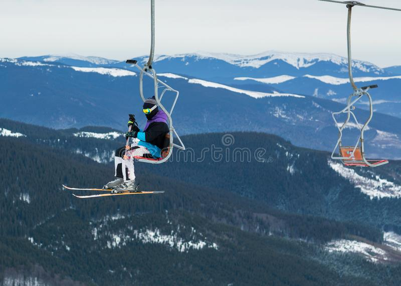 Skier on a platform on a background of high snow mountains stock image