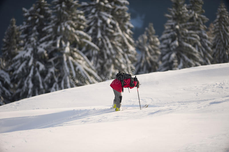 Skier resting in deep snow after recreational skiing stock photography