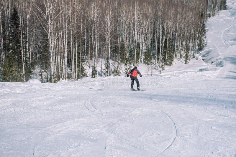 A skier rides down the mountain. Winter sport. Dangerous sport. Winter landscape. Winter in Siberia. To ski stock photos