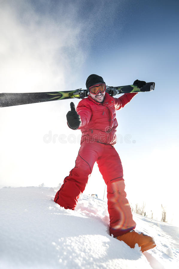 Skier showing thumbs up royalty free stock image