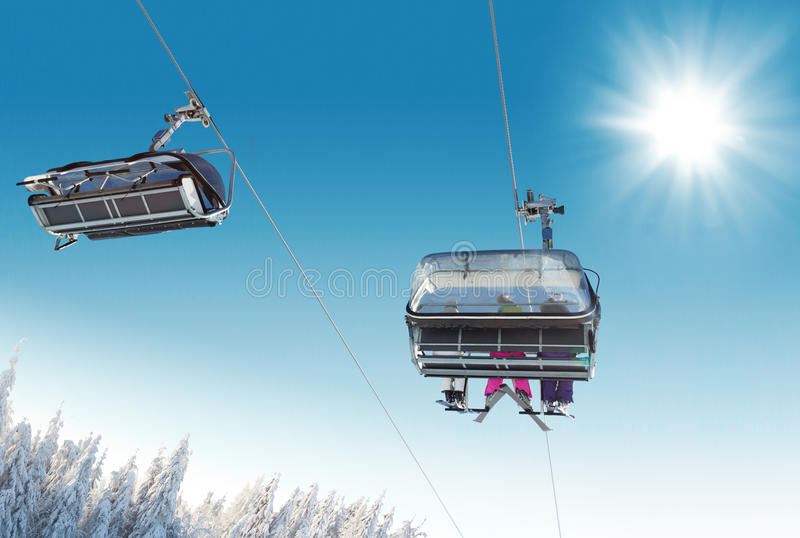 Skier sitting at ski lift. In high mountains stock photos