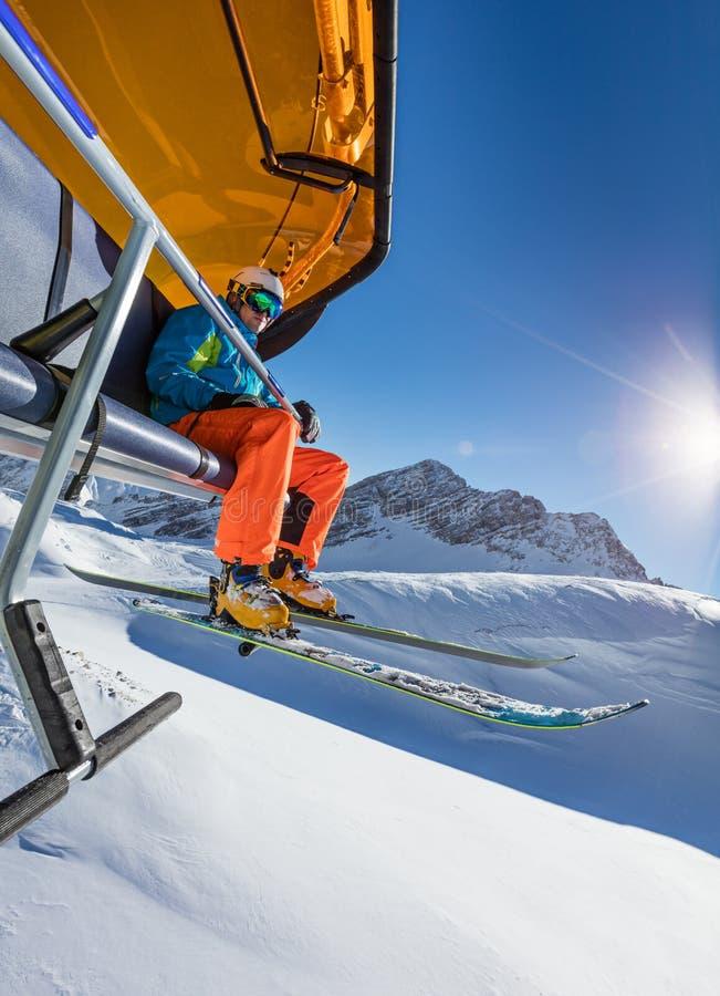 Skier sitting at ski lift. royalty free stock photo