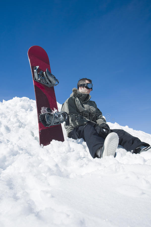 Skier sitting in snow royalty free stock photos