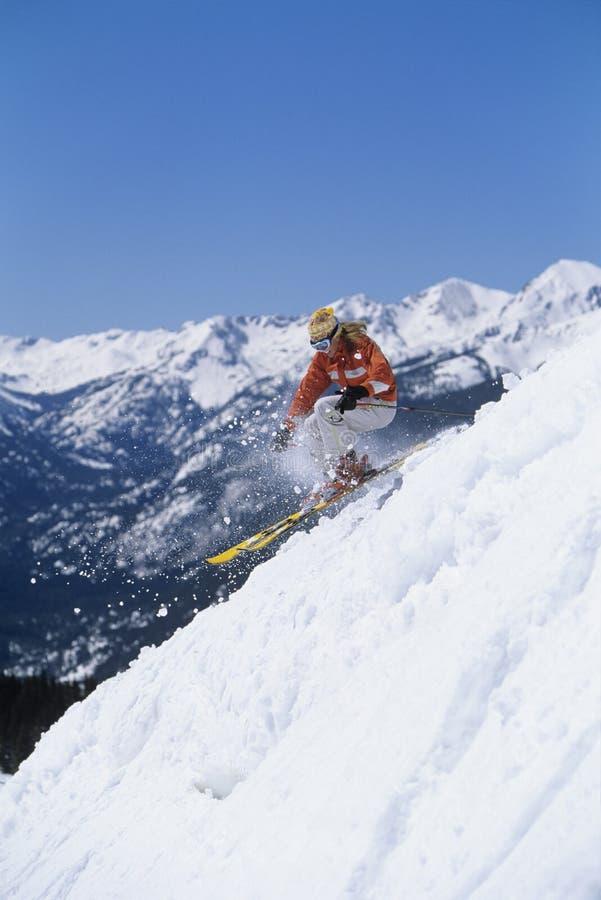 Skier Skiing Down Ski Slope stock photos