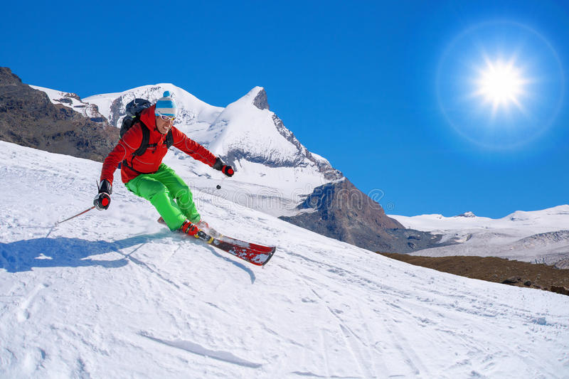 Skier skiing downhill in high mountains, Matterhorn, Switzerland. Skier skiing downhill in high mountains, Matterhorn area, Switzerland royalty free stock photography