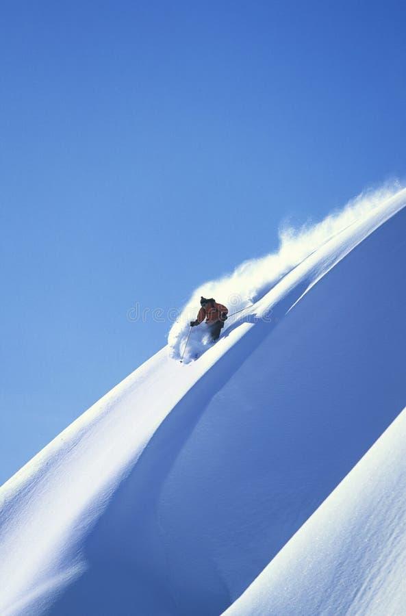 Skier Skiing On Steep Slope stock image