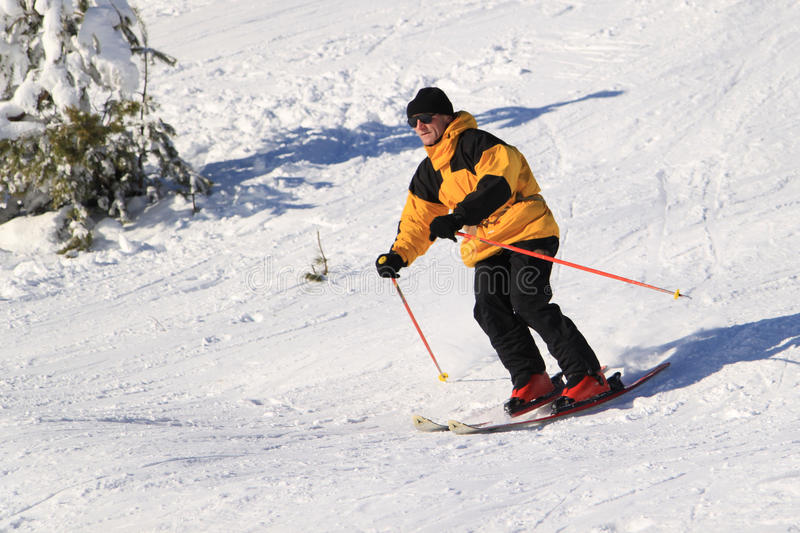 Skier on a slope stock photo