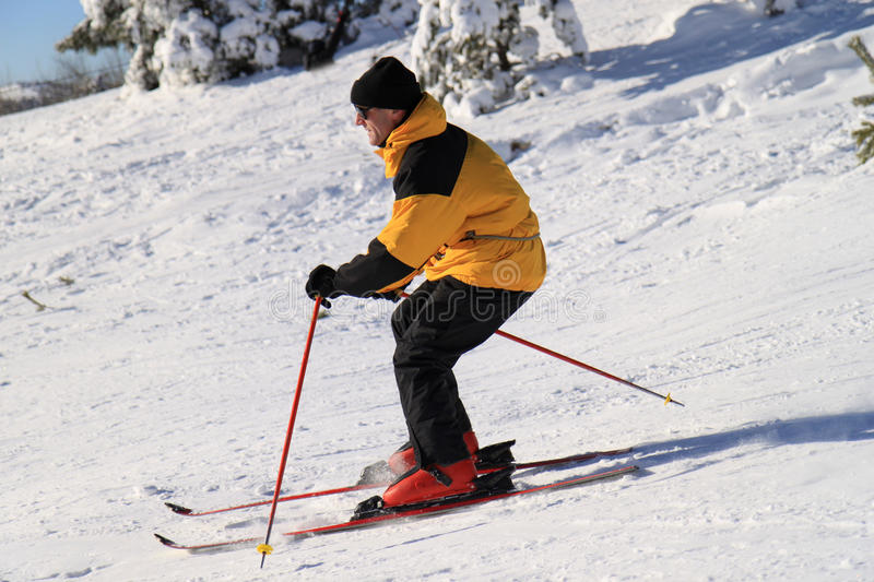 Skier on a slope stock photography