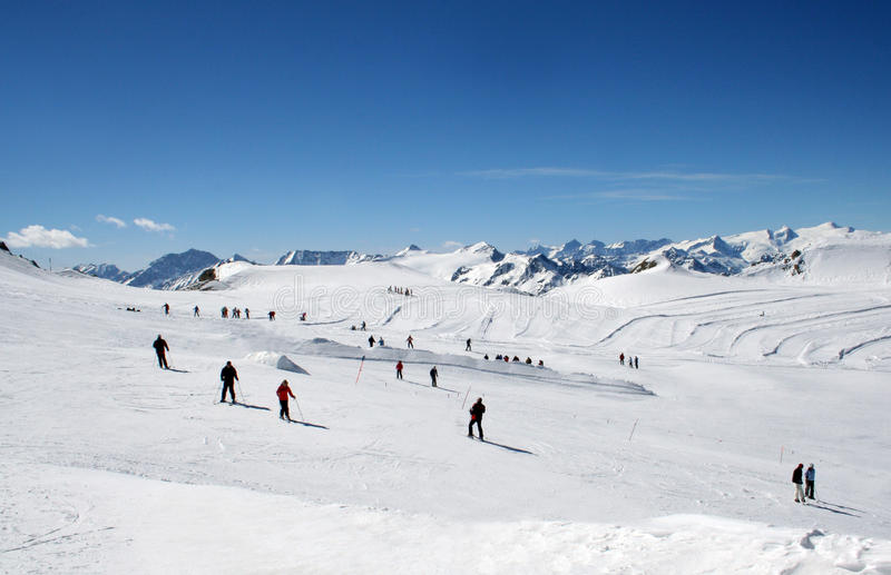 Download Skiers on Alpine ski slope stock image. Image of alps - 14269385