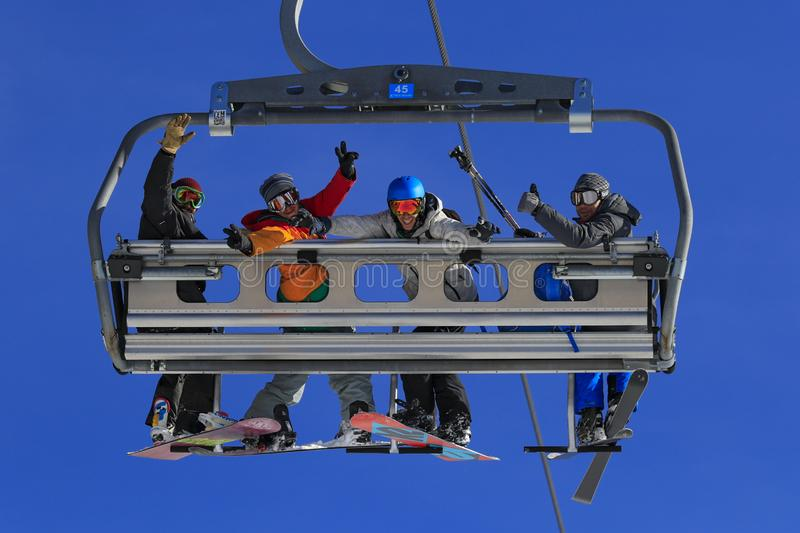 Skiers in chair lift royalty free stock images