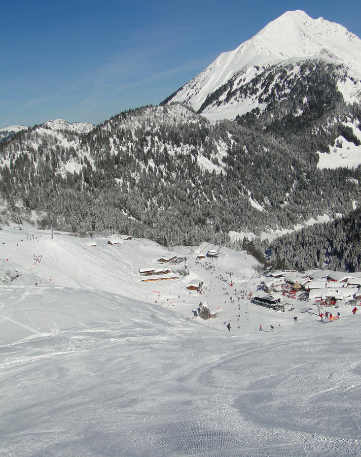 Download Skiers Descend To Tiny Mountain Village Stock Image - Image: 14930663