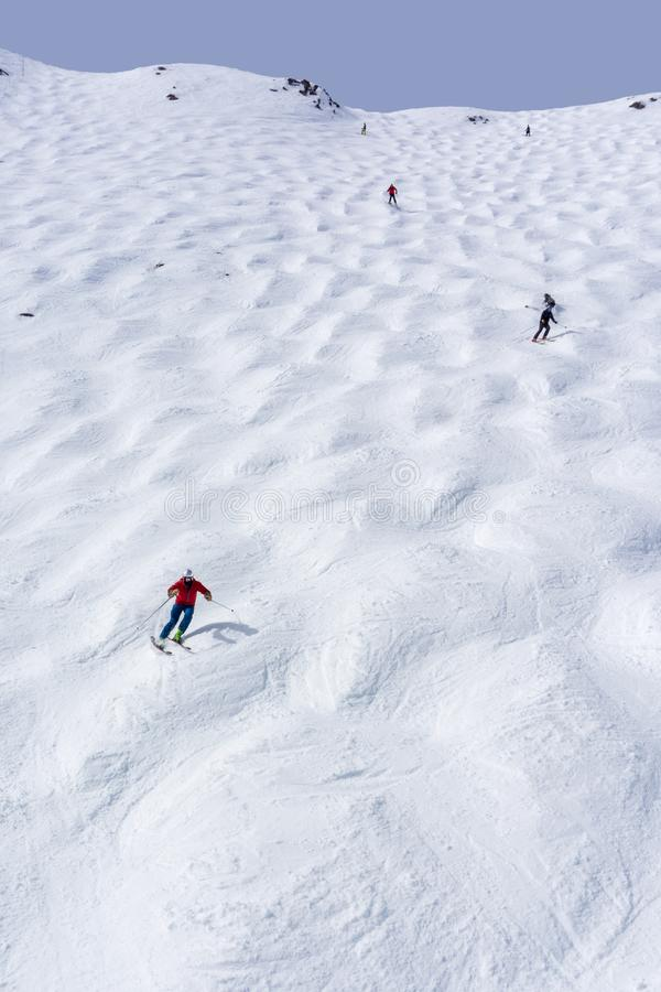 Mogul Ski Slope at Lake Louise in the Canadian Rockies. Skiers descending the steep mogul ski hill slope at a mountain in Lake Louise in the Canadian Rockies of royalty free stock photography