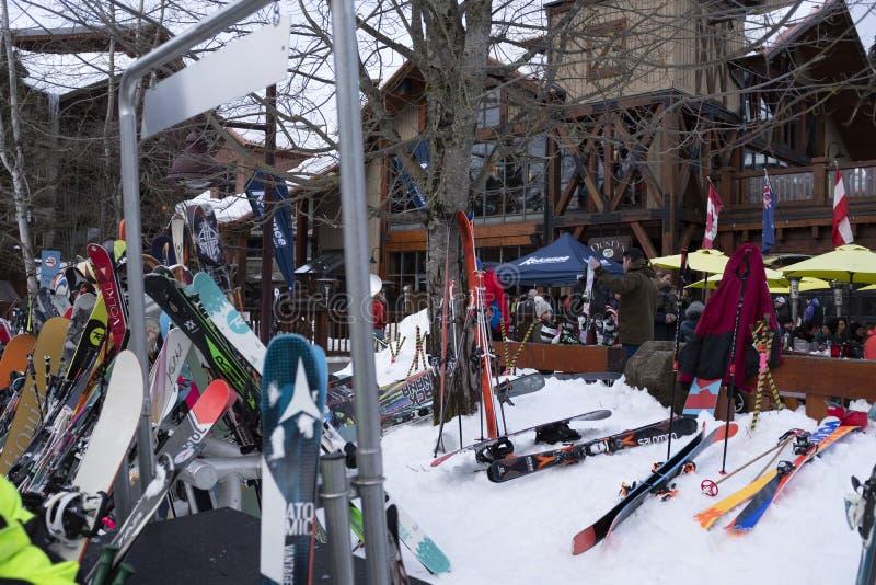 Skiers enjoying apres ski at Dusty`s at Creekside Village ski resort, British Columbia stock photo