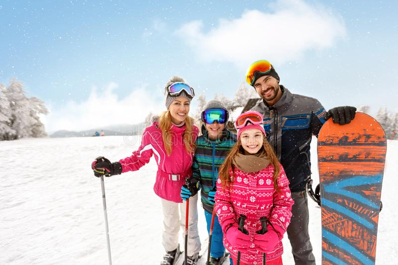 Skiers family together on skiing royalty free stock images