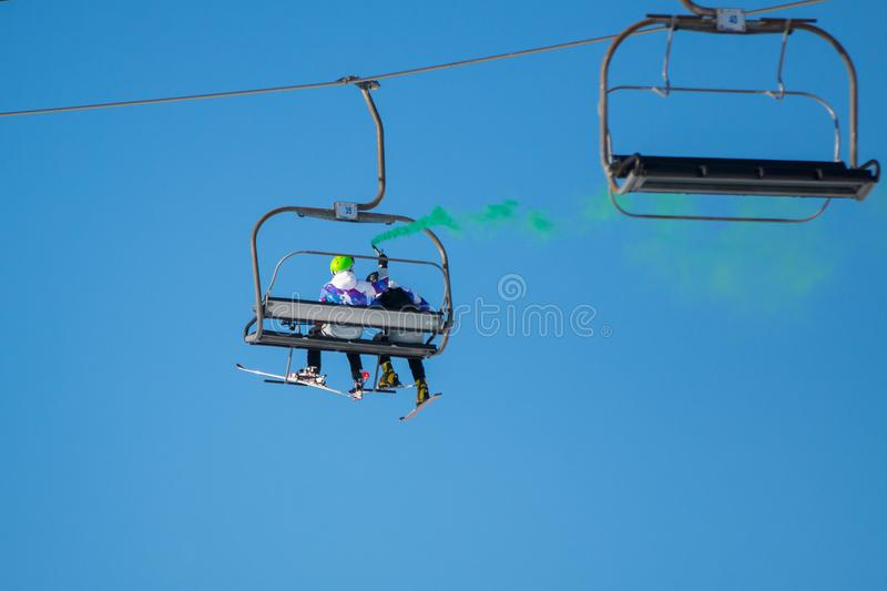 Skiers on a funicular railway cable car stock photography