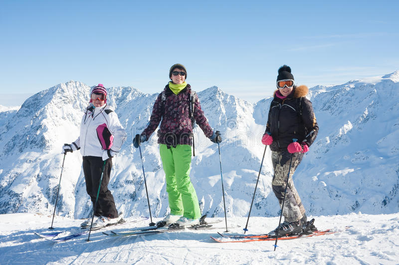 Download Skiers Mountains In The Background Stock Image - Image: 27077351