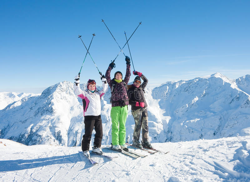 Download Skiers Mountains In The Background Stock Photo - Image: 27077398