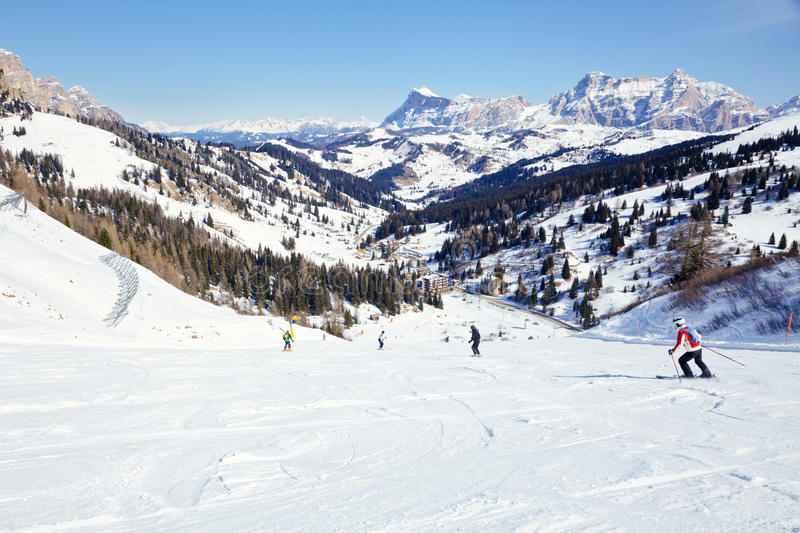 Skiers on a piste stock photo