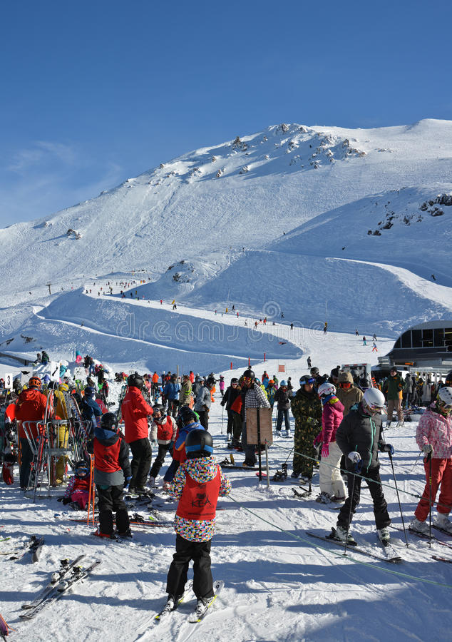 Skiers prepare for The Chairlift at Mount Hutt Ski Field, New Zealand royalty free stock image