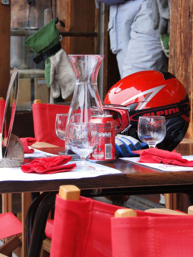 Skiers rehydrate. PORTES DU SOLEIL, FRANCE - Mar 2 - Skiers rehydrate after a long morning of skiing, on Mar 2, 2010, at the Portes du Soleil, France stock images