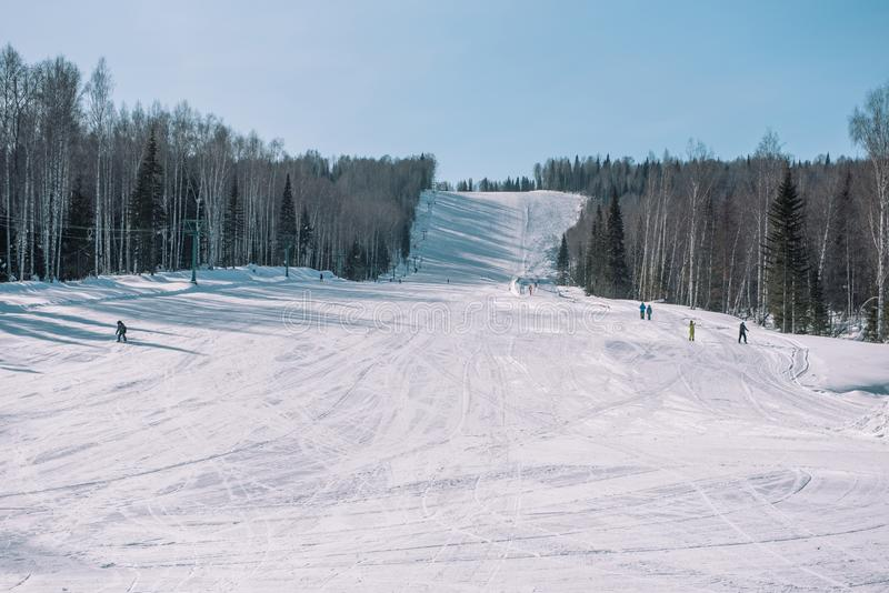 Skiers ride from the mountain. Ski resort. Winter in Siberia. Winter landscape. Beautiful nature stock image