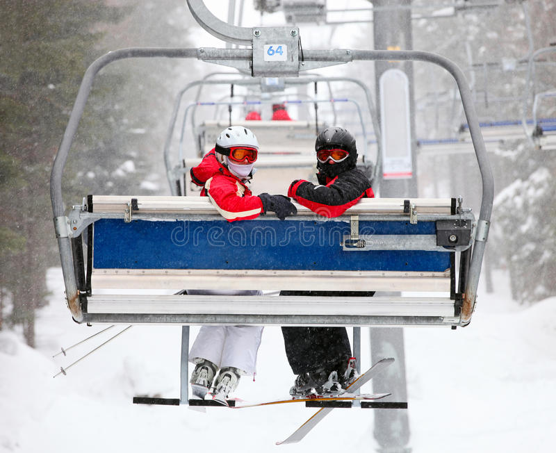 Skiers on a ski-lift royalty free stock photography