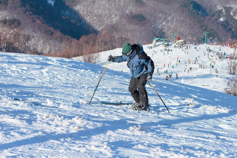 Skiers on ski slopes in Carpathian mountains stock image