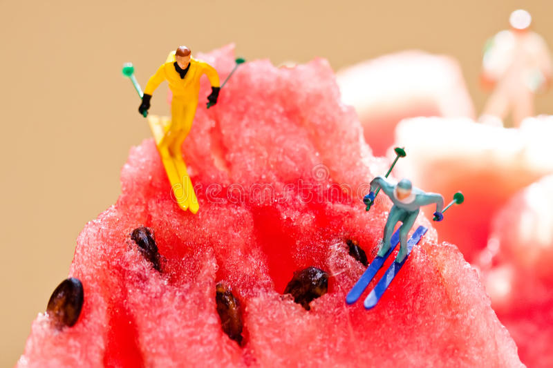 Skiers sliding from watermelon mountains. Creative summer party concept. winter lifestyle, sport activity extreme image stock photos