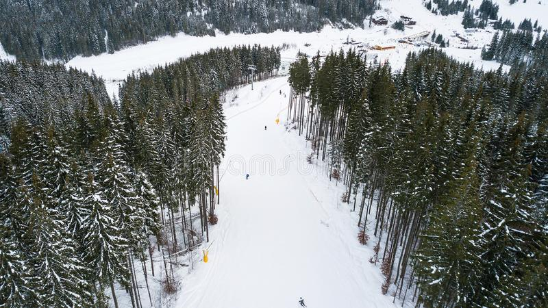 Skiers and snowboarders go down the slope in a ski resort Bukovel, Ukraine stock images