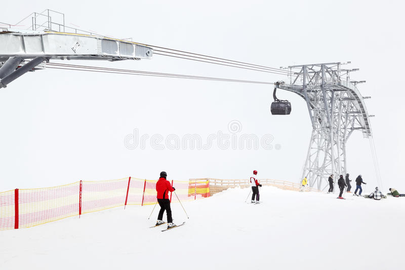Skiers and snowboarders ride in Alps royalty free stock photos