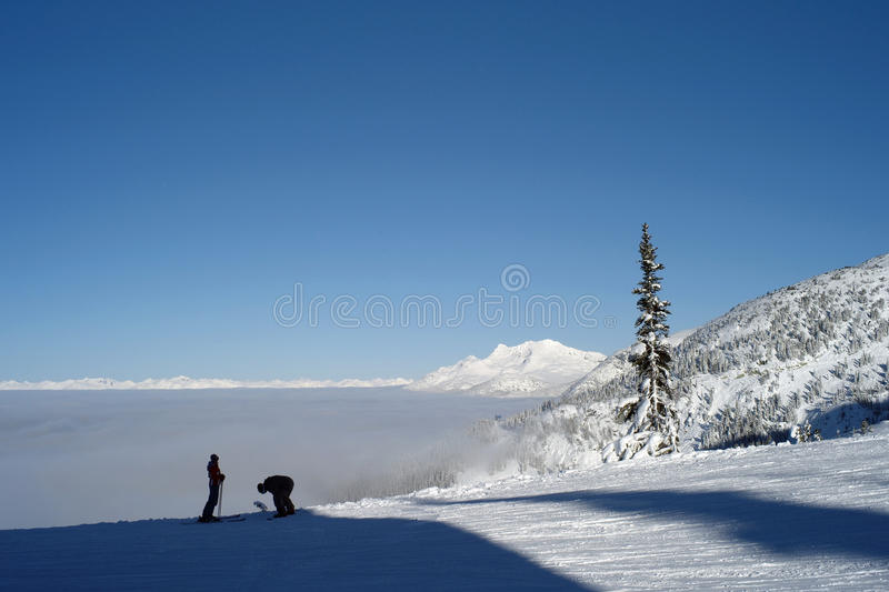 Skiers a top the mountain royalty free stock image
