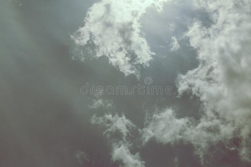 Gun metal silver sky and clouds. Skies the color of a silver bullet and clouds with highlights of turquoise stock image