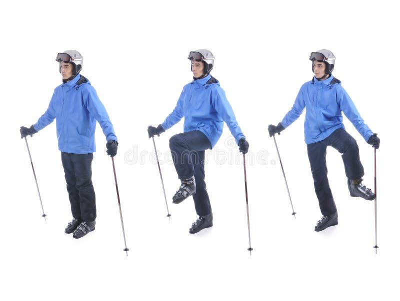 Skifahrer demonstrieren Aufwärmenübung für das Ski fahren lizenzfreie stockbilder