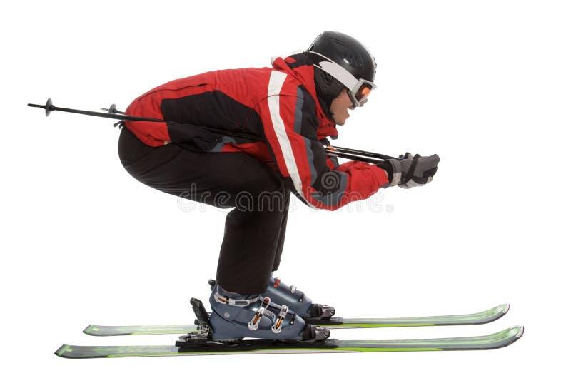 Skifahrermann in der aerodynamischen Haltung lizenzfreies stockbild