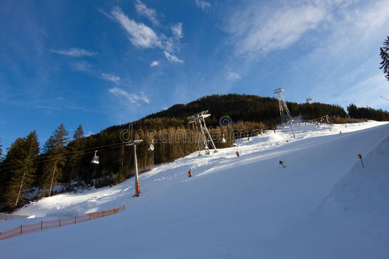 Skihelling in Oostenrijk stock afbeelding