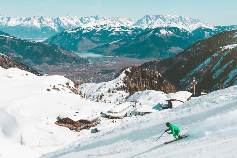 Skiier on mountain slopes stock images