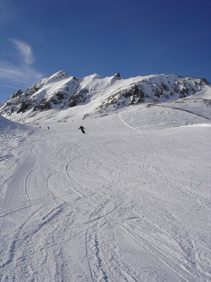 Skiing in the Alpes stock photography