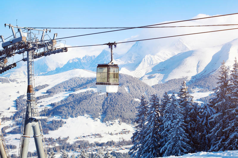 Skiing in Alps, ski lift cabine in mountains. Skiing in Alps, ski lift cabine and beautiful mountain panoramic landscape royalty free stock images