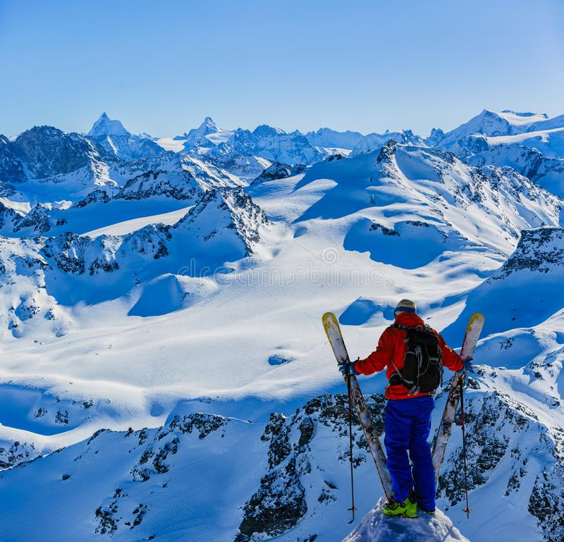 Skiing with amazing view of swiss famous mountains in beautiful winter snow Mt Fort. The matterhorn and the Dent d`Herens. In th. E foreground the Grand Desert royalty free stock photography