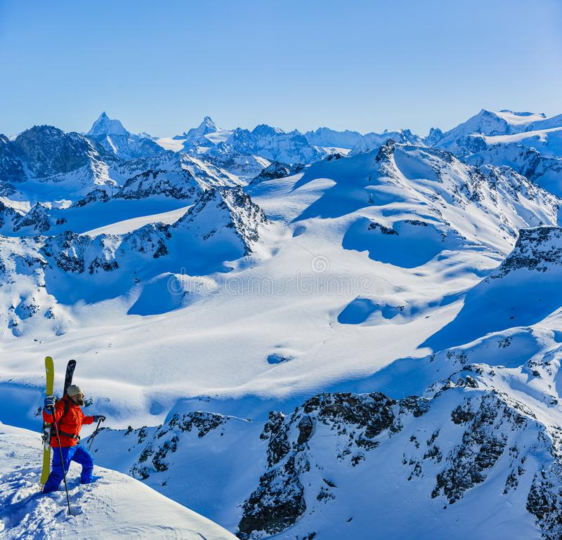 Skiing with amazing view of swiss famous mountains in beautiful winter snow Mt Fort. The matterhorn and the Dent d`Herens. In th. E foreground the Grand Desert stock photography
